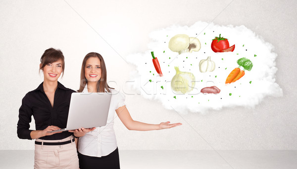 Young girl presenting nutritional cloud with vegetables  Stock photo © ra2studio