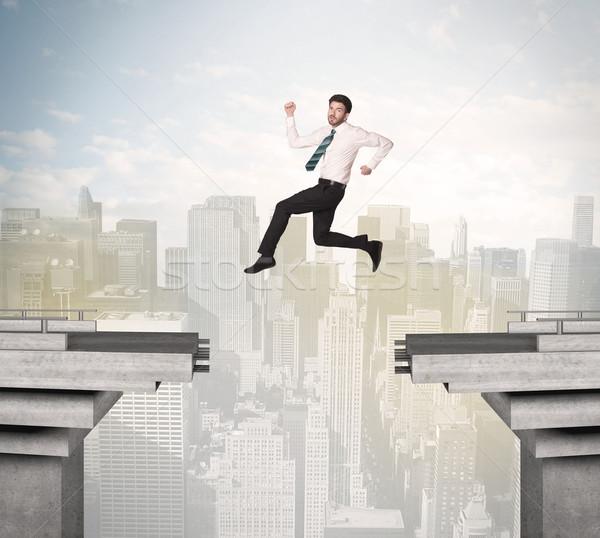 энергичный деловой человек прыжки моста разрыв человека Сток-фото © ra2studio