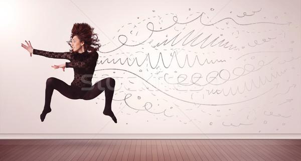 Jolie femme sautant dessinés à la main lignes Photo stock © ra2studio