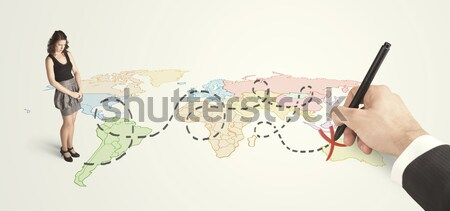 Businesswoman looking at map and route drawn by hand Stock photo © ra2studio