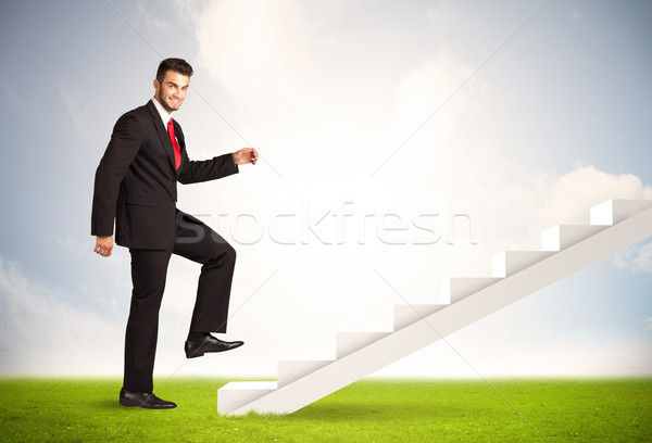 Business person climbing up on white staircase in nature Stock photo © ra2studio
