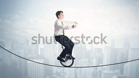 Enérgico homem de negócios saltando ponte lacuna céu Foto stock © ra2studio