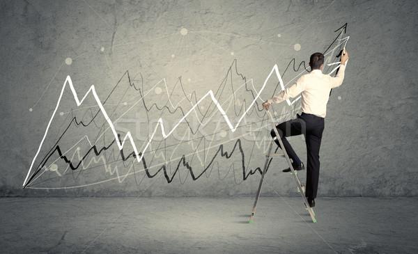 Man on ladder drawing lines Stock photo © ra2studio