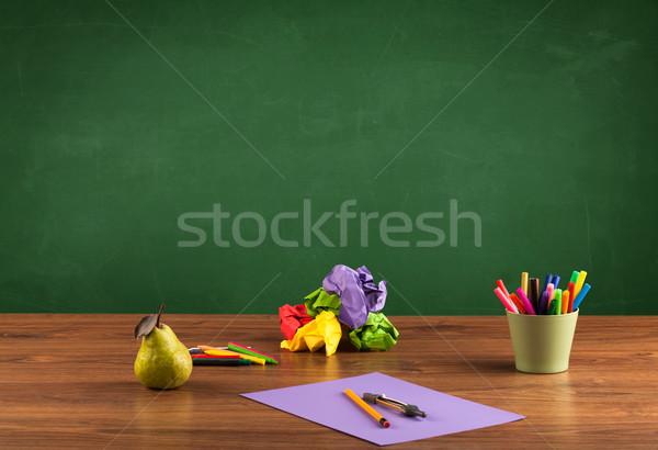 School items on desk with empty chalkboard Stock photo © ra2studio