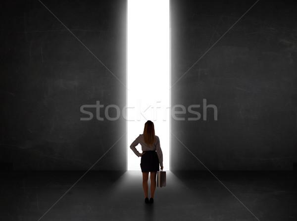 üzletember néz fal fény alagút nyitás Stock fotó © ra2studio