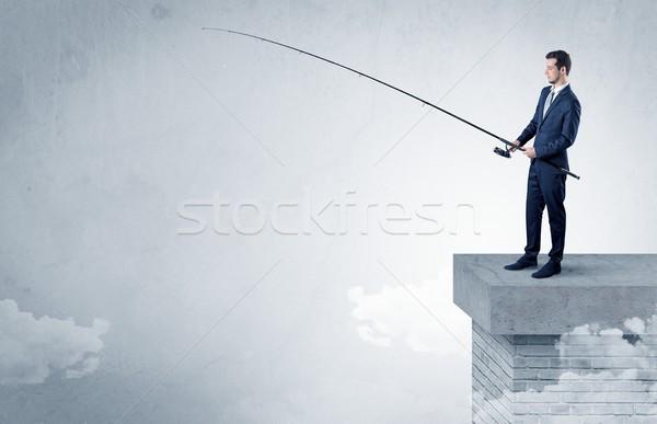 бизнесмен рыбалки ничего Top облаке свободный Сток-фото © ra2studio