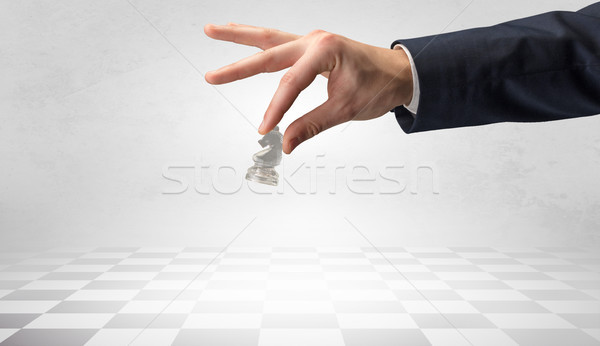 Big hand taking his next step on chess game Stock photo © ra2studio