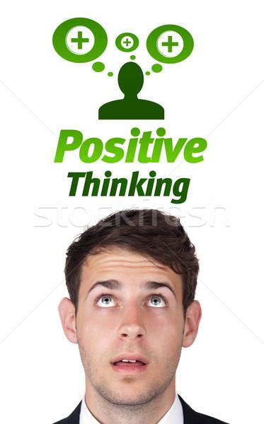 Młodych głowie patrząc pozytywny negatywne znaki Zdjęcia stock © ra2studio