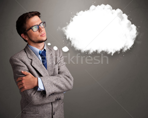 Good-looking young man thinking about cloud speech or thought bubble Stock photo © ra2studio