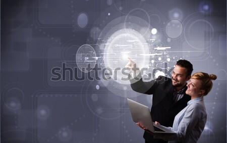 Felice Coppia toccare abstract alta tecnologia Foto d'archivio © ra2studio