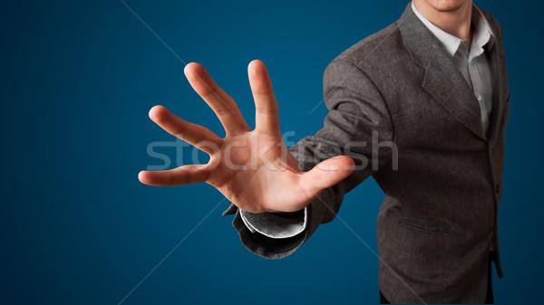 üzletember kisajtolás képzeletbeli gomb fiatal üzlet Stock fotó © ra2studio