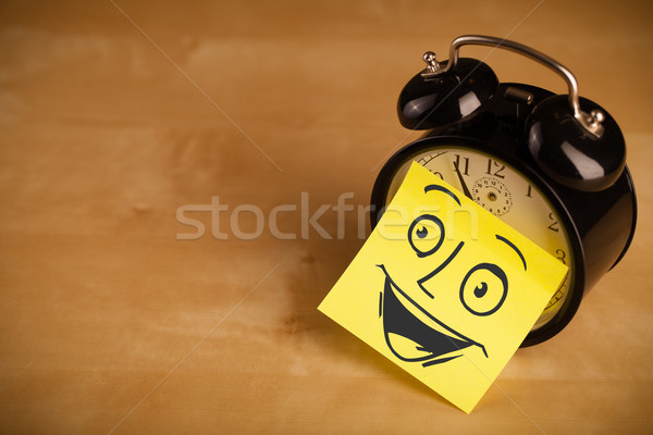Post-it note with smiley face sticked on clock Stock photo © ra2studio