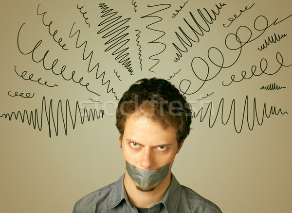 Young man with glued mouth and curly lines Stock photo © ra2studio