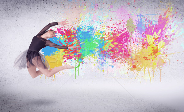 Modern street dancer jumping with colorful paint splashes Stock photo © ra2studio