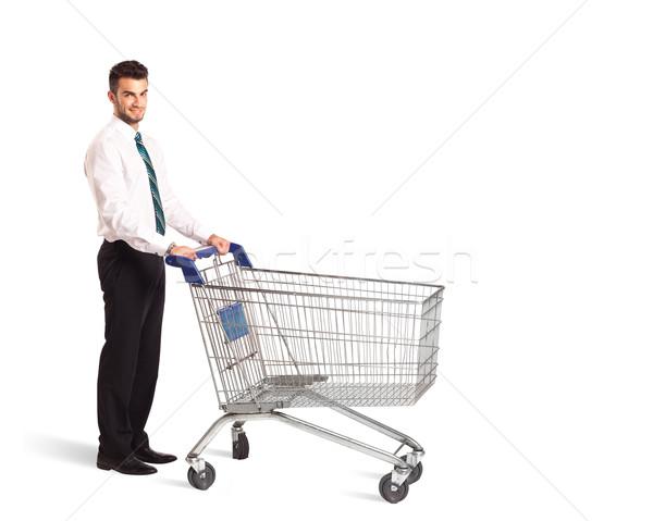Biznesmen koszyk popychanie odizolowany sklep rynku Zdjęcia stock © ra2studio