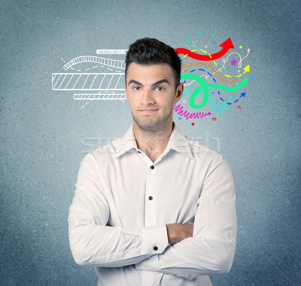 Happy creative business guy with illustration Stock photo © ra2studio