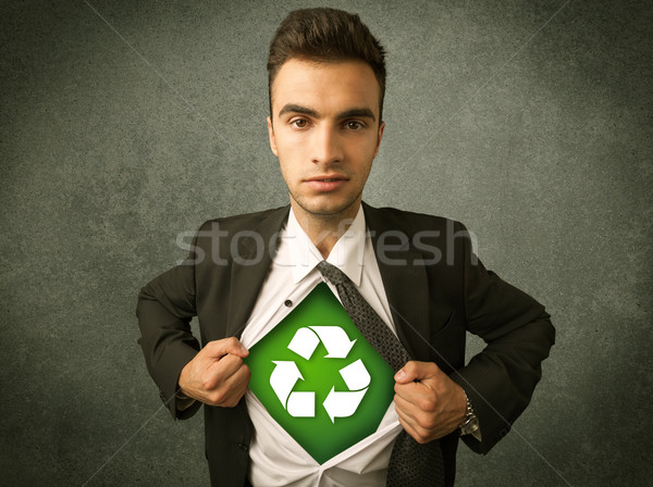 Enviromentalist business man tearing off shirt with recycle sign Stock photo © ra2studio
