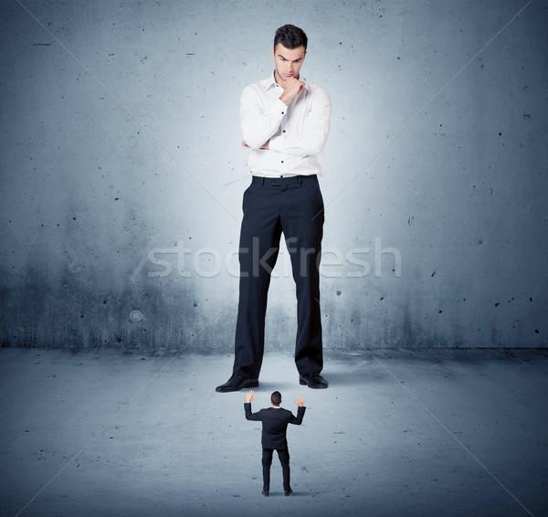 Arrabbiato enorme uomo d'affari piccolo ragazzo collega Foto d'archivio © ra2studio