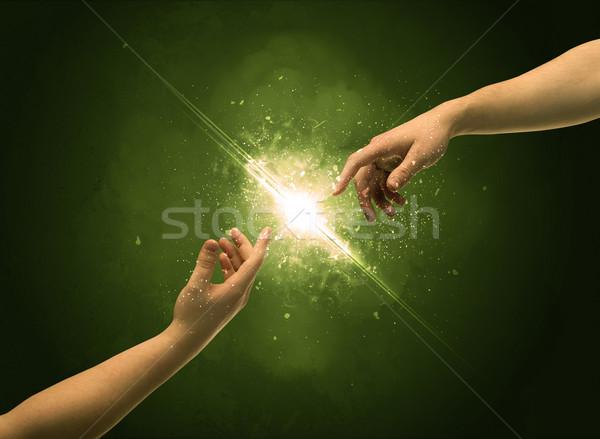 Dotknąć broni oświetlenie iskra palec dwa Zdjęcia stock © ra2studio