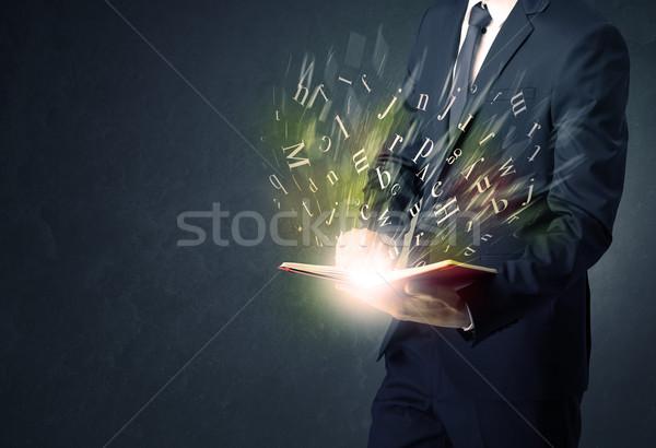 Businessman holding a book. Stock photo © ra2studio