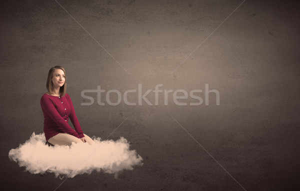 Woman sitting on a cloud with plain bakcground Stock photo © ra2studio