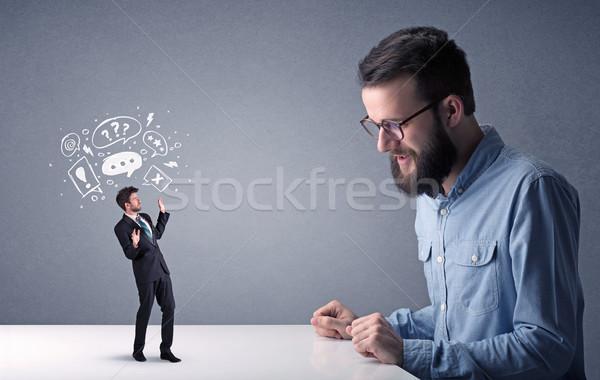 Jovem empresário miniatura profissional zangado Foto stock © ra2studio