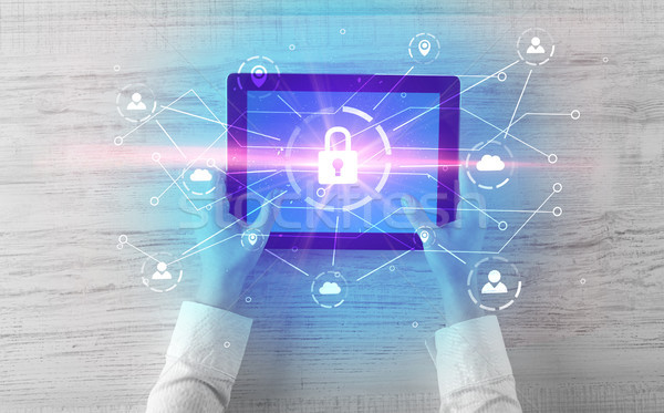 Hand using tablet with network security and online storage system concept Stock photo © ra2studio