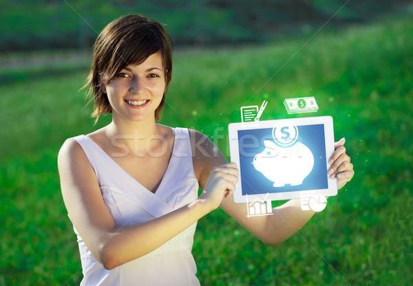 Fiatal üzletasszony néz modern tabletta absztrakt Stock fotó © ra2studio