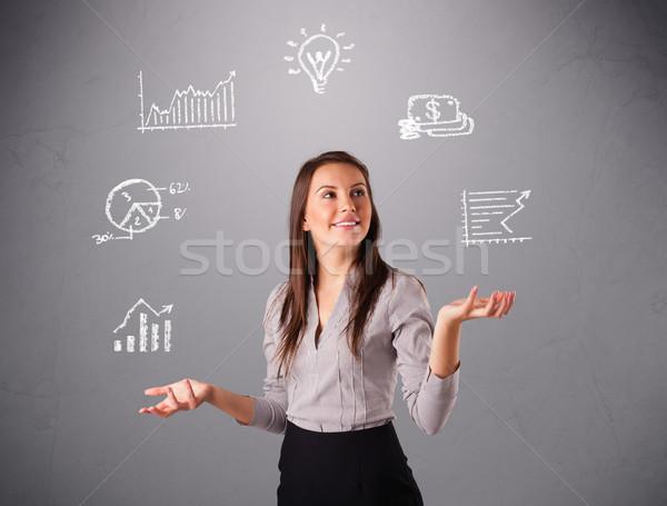 Gyönyörű fiatal nő zsonglőrködés statisztika grafikonok kéz Stock fotó © ra2studio