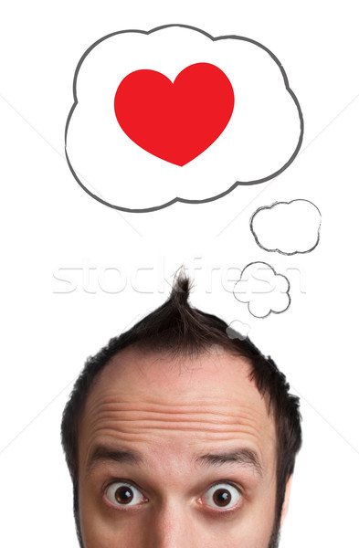 Young head looking at love type of icons Stock photo © ra2studio