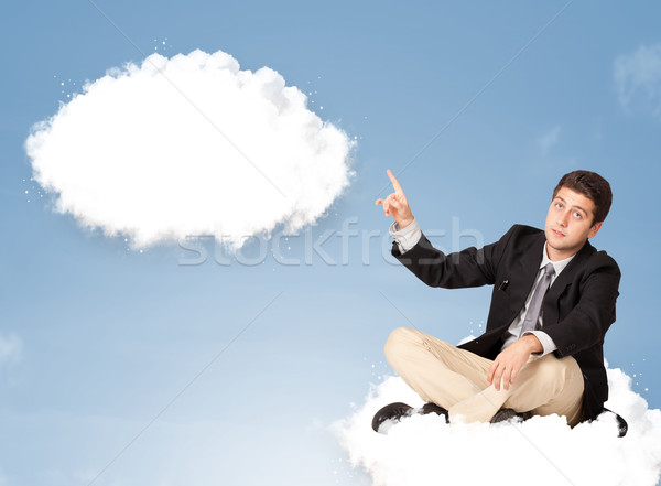 Handsome young man sitting on cloud and thinking of abstract speech bubble Stock photo © ra2studio