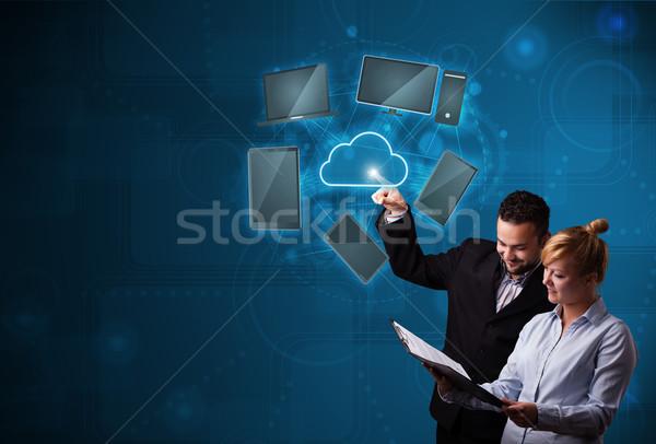 Happy couple touching cloud service Stock photo © ra2studio