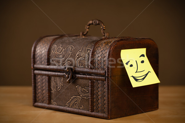 Post-it note with smiley face sticked on a box Stock photo © ra2studio