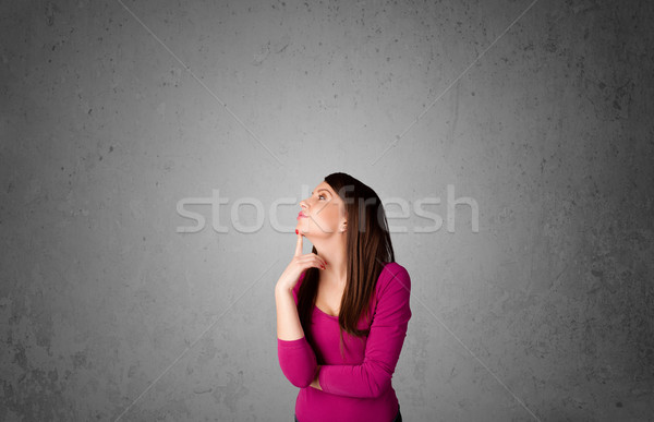 Young woman gesturing with copy space Stock photo © ra2studio