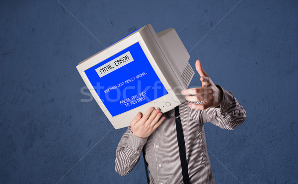 Person with a monitor head and fatal error blue screen on the di Stock photo © ra2studio
