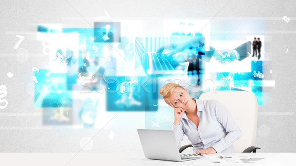 Business person at desk with modern tech images at background Stock photo © ra2studio