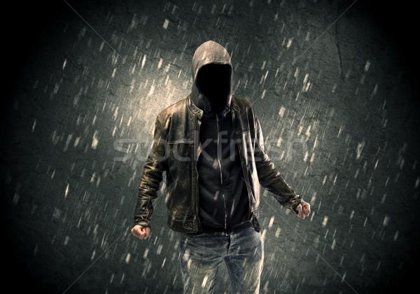 Stock photo: Unknown suspect standing in the dark