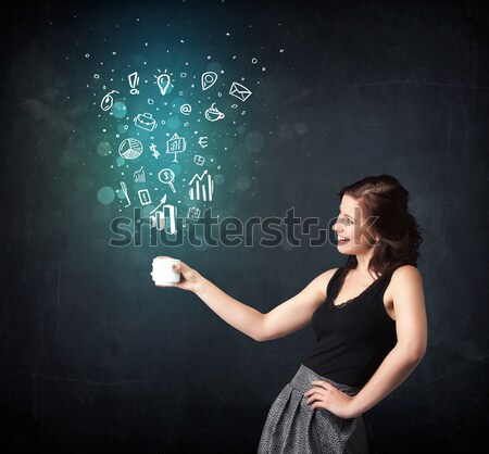 Businesswoman holding a white cup with business icons Stock photo © ra2studio