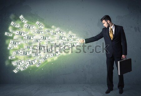 Stock photo: Business person throwing a lot of dollar bills concept