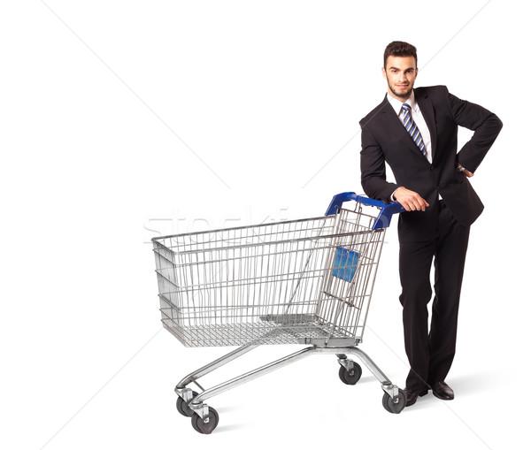 Biznesmen koszyk popychanie odizolowany pracy garnitur Zdjęcia stock © ra2studio