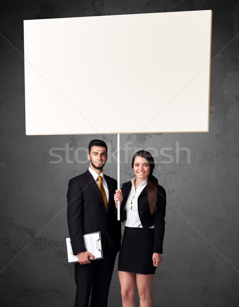 Business couple with blank whiteboard Stock photo © ra2studio