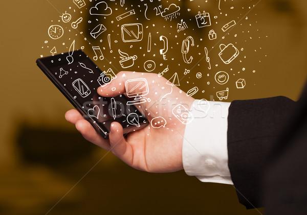 Stock fotó: Kéz · tart · okostelefon · kézzel · rajzolt · média · ikonok