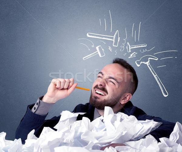Businessman above crumpled paper Stock photo © ra2studio