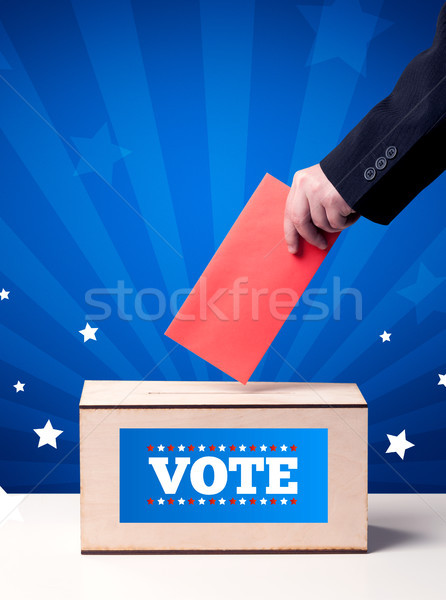 hand with ballot and wooden box Stock photo © ra2studio