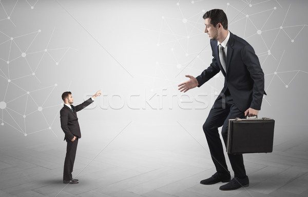 Small man aiming at a big man with network concept Stock photo © ra2studio