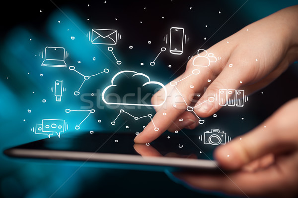 Hand working on tablet with cloud technology system concept Stock photo © ra2studio