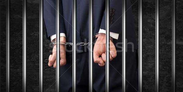 Cerca hombre cárcel esposas detrás Foto stock © ra2studio