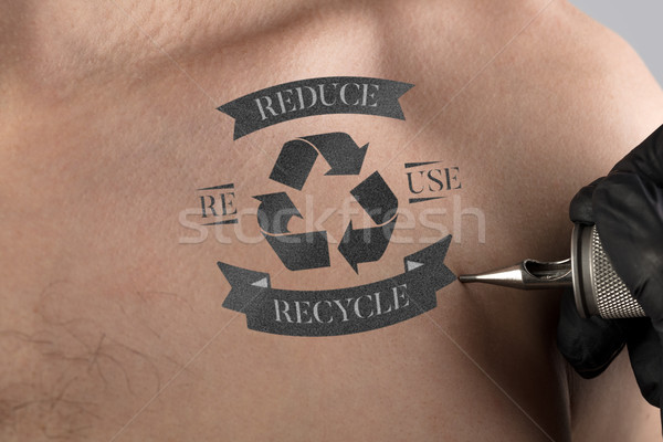 Tattooing recycle for a better environment concept on naked back Stock photo © ra2studio