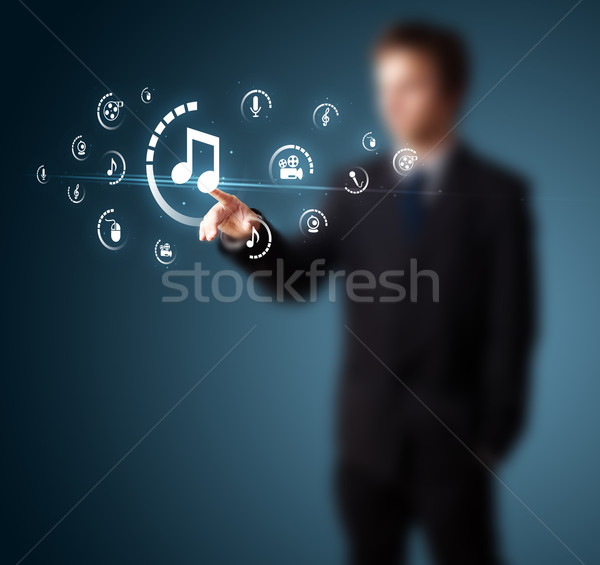 Stock photo: Businessman pressing virtual media type of buttons