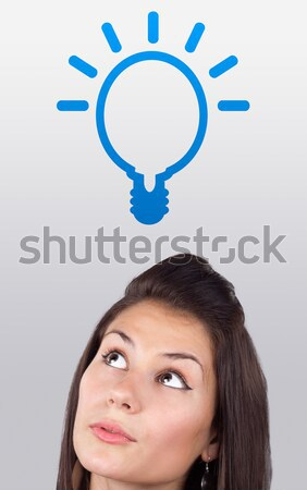 Young girl looking at idea type of sign Stock photo © ra2studio